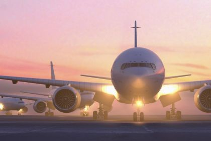 airplanes-taxiing-on-runway-at-sunset-685007399-5a7cd2b1fa6bcc0037137e1d-1565342296531745109050.jpg